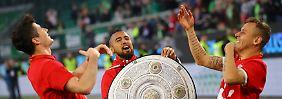 Heißa, welch' Freude: Robert Lewandowski, Arturo Vidal und Rafinha in Wolfsburg.