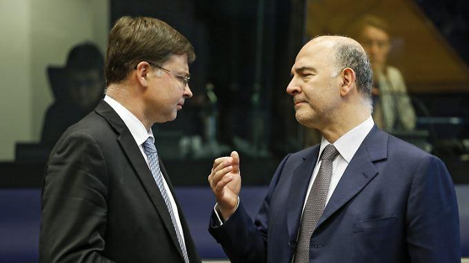 Die beiden EU-Kommissare Dombrovskis (l.) und Moscovici (r.) im Gespräch über die Zukunft der Europäischen Union.