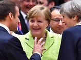 Bleiberecht für Millionen Bürger: Merkel lobt Mays Vorstoß zu EU-Bürgern