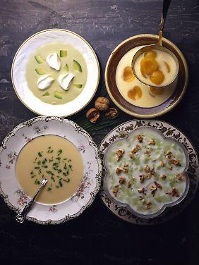 Kalte Suppen für heißeTage: Geeiste Suppen mit Avocado (o.l.) und Aprikosen (o.r.), Vichyssoise mit Porree und Kartoffeln (u.l.) und Tarator mit Gurken, Knoblauch, Dill und Walnüssen (u.r.).