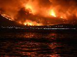 Tausende Urlauber auf der Flucht: Großbrand in Athen gerät außer Kontrolle