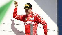 Walks like an Egyptian: Vettels Sebastian nach dem Sieg in Ungarn.