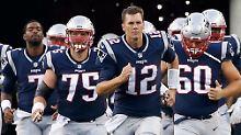 Auf ein Neues: Tom Brady und doe Footballer der  New England Patriots.