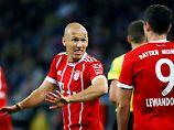 Eher gereizt: Arjen Robben und Robert Lewandowski.