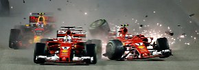... und seinem Ferrari-Teamkollegen Kimi Räikkönen.