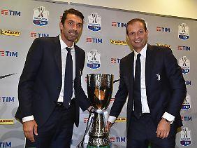 Gianluigi Buffon und sein Trainer Massimiliano Allegri sind sich einig: Der Videobeweis ist nicht gut.