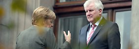 Nach dem schwachen Wahlergebnis stehen Angela Merkel und Horst Seehofer in den Jamaika-Verhandlungen unter Druck.