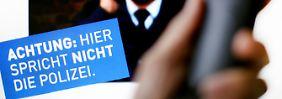 Betrug am Telefon: Falschen Polizisten nichts erzählen