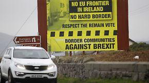 """Erste Brexit-Deals beschlossen: May garantiert """"keine harte Grenze"""" zu Nordirland"""