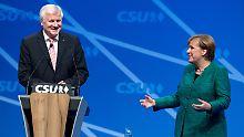 Auftritt beim CSU-Parteitag: Merkel und Seehofer geben sich harmonisch