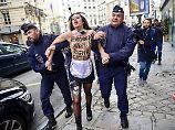 Paris-Besuch mit Hindernissen: Erdogan von halbnackten Frauen begrüßt
