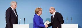 Kanzlerin Merkel und SPD-Chef Schulz sind sich bereits einig - doch entscheidet sich auch die sozialdemokratische Basis für eine neue GroKo?