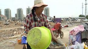 """""""Wie Verbrecher behandelt"""": Chinas Regierung vertreibt Wanderarbeiter mit Gewalt aus Metropolen"""