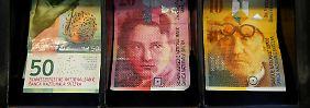 Strafzinsen und Währungsgewinne: Schweizer Notenbank verdoppelt Überschuss