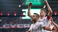 So sehen Sieger aus: Thiago und Thomas Müller.
