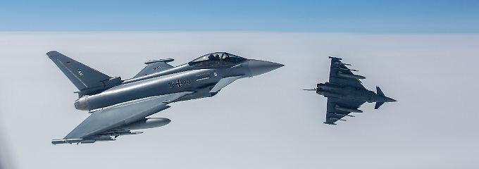 Panzer und Jets: Berlin und Paris besiegeln Rüstungsdeal