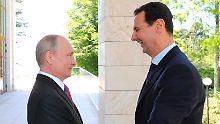 Größe ist relativ: Putin (l.) und Assad bei ihrem Treffen in Sotschi