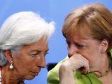 IWF-Chefin in Berlin: Lagarde und Merkel zwitschern Trump etwas