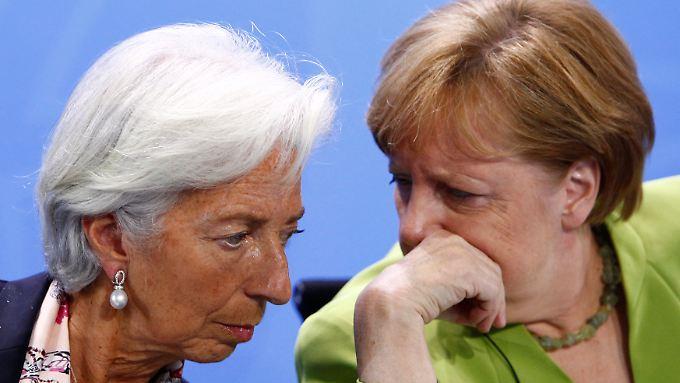 Lagarde und Merkel trafen in Berlin zusammen - beide hatten das G7-Fiasko in Kanada persönlch miterlebt.