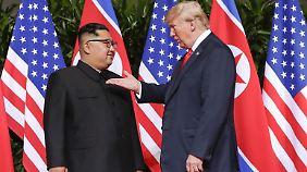 """""""Ich glaube, wir verstehen uns"""": Kim und Trump."""