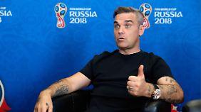 Anstoß mit Ball aus dem All: Robbie Williams und Fußballfans fiebern WM-Eröffnung entgegen