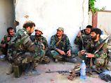 Syrische Soldaten machen eine Pause in Ost-Ghuta (Archivbild).