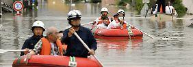 """""""Nie dagewesene Niederschläge"""": Dutzende Japaner sterben durch Unwetter"""