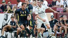 Gareth Bale (r., hier mit Claudio Marchisio) traf für Real Madrid zum zwischenzeitlichen Ausgleich im Test gegen Juventus Turin.