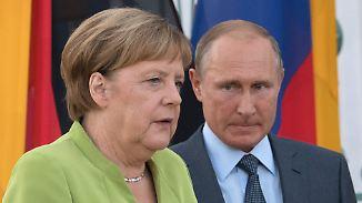 Angespanntes Treffen mit Merkel: Putin bekommt keine Blumen