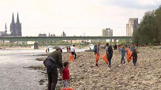 World Cleanup Day: Tausende Freiwillige befreien Rheinufer von 80 Tonnen Müll