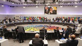 Merkel im Stress, Putin und Trump uneins: G20 einigen sich auf Minimalkonsens
