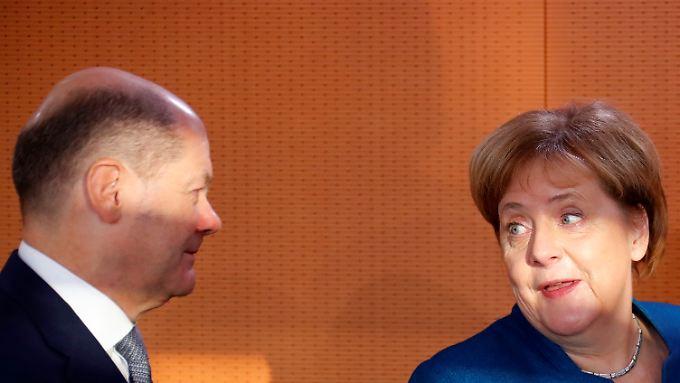 Finanzminister Scholz und Kanzlerin Merkel können mit zusätzlichen Milliarden planen.