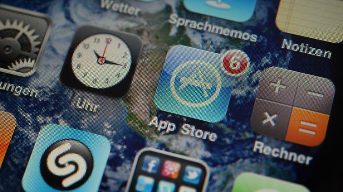 Apple iPhone 3Gs, auf dem die Icons verschiedener Apps (Programme) angezeigt werden.