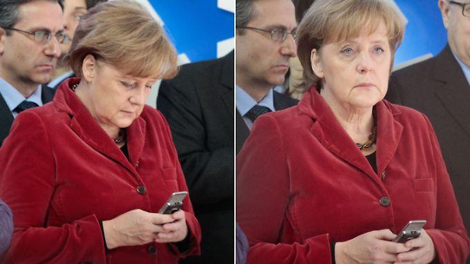 Die SMS kommt an - Merkel guckt ein wenig entgeistert.