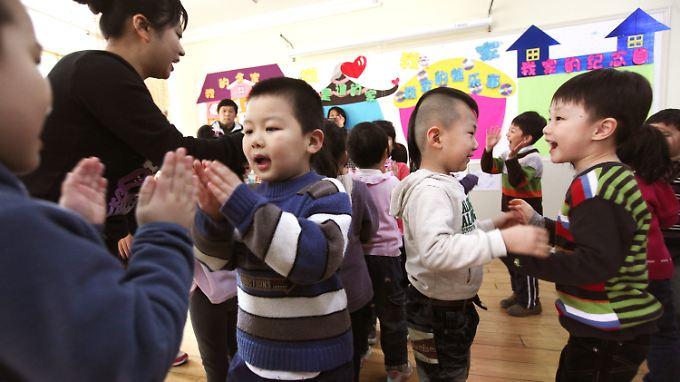 Kinder in Peking in einem Kindergarten: Im Land der Ein-Kind-Politik ist jeder Nachwuchs für die Eltern besonders kostbar, weil einmalig.