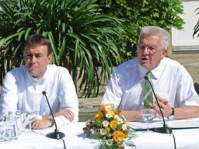 Die SPD um den damaligen Spitzenkandidaten und heutigen Finanzminister Nils Schmid (l.) kann sich behaupten.