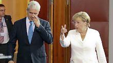 Bundeskanzlerin Angela Merkel sagt dem Präsidenten Boris Tadic, was sie sich von Serbien wünscht.