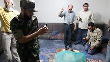 """Wie kam Gaddafi zu Tode?: """"Schüsse aus nächster Nähe in Kopf und Bauch"""""""