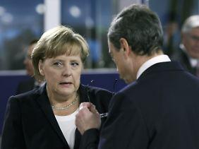 Kanzlerin Merkel und EZB-Chef Draghi beim G20-Gipfel in Cannes.