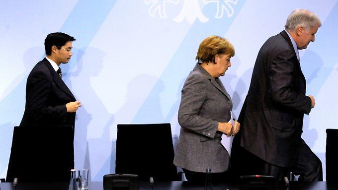 Rösler, Merkel, Seehofer: endlich in eine Richtung?