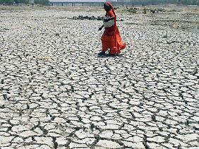 Ein ausgetrocknetes Flussbett in Indien. Vor allem arme Regionen werden zunehmend unter dem Klimawandel leiden.