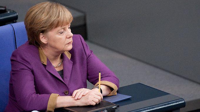 Kanzlerin Merkel muss eine schwere Schlappe hinnehmen.