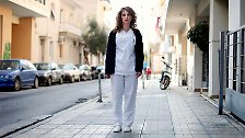 Pauline Delli, 32, a psychiatric nurse, poses in the street outside her place of work in Athens March 27, 2012. When asked how she had been affected by the economic crisis, Delli replied, 'I am just living day to day and not thinking about the future.' Picture taken March 27, 2012.