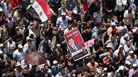Anhänger von Mohammed Mursi feiern auf dem Tahrir-Platz in Kairo.
