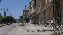 Zerstörte Gebäude in Al-Rasten bei Homs.