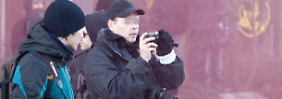"""Der mutmaßliche NSU-Unterstützer Thomas R. aus Halle (mit schwarzer Base-Cap) bei einem Neonazi-""""Trauermarsch"""" in Magdeburg im Januar."""