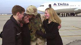 Da scheint die Welt noch in Ordnung: Petraeus mit seiner Familie im Februar 2004.