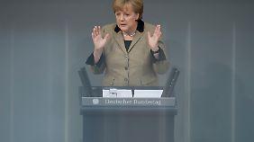 Merkel glaubt nicht an eine rasche Lösung in der Schuldenkrise.