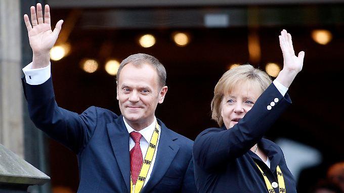 """""""Krise als Chance"""": Tusk und Merkel wollen die EU-Zusammenarbeit ausbauen."""