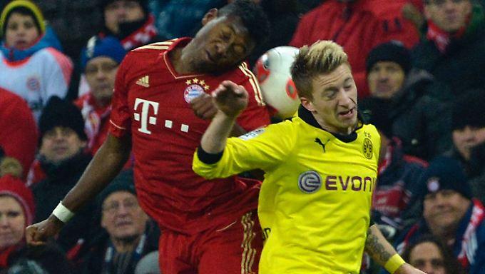 Und wo ist der Ball? Dortmunds Marko Reus und der Münchner David Alaba bemühen sich um ihn.
